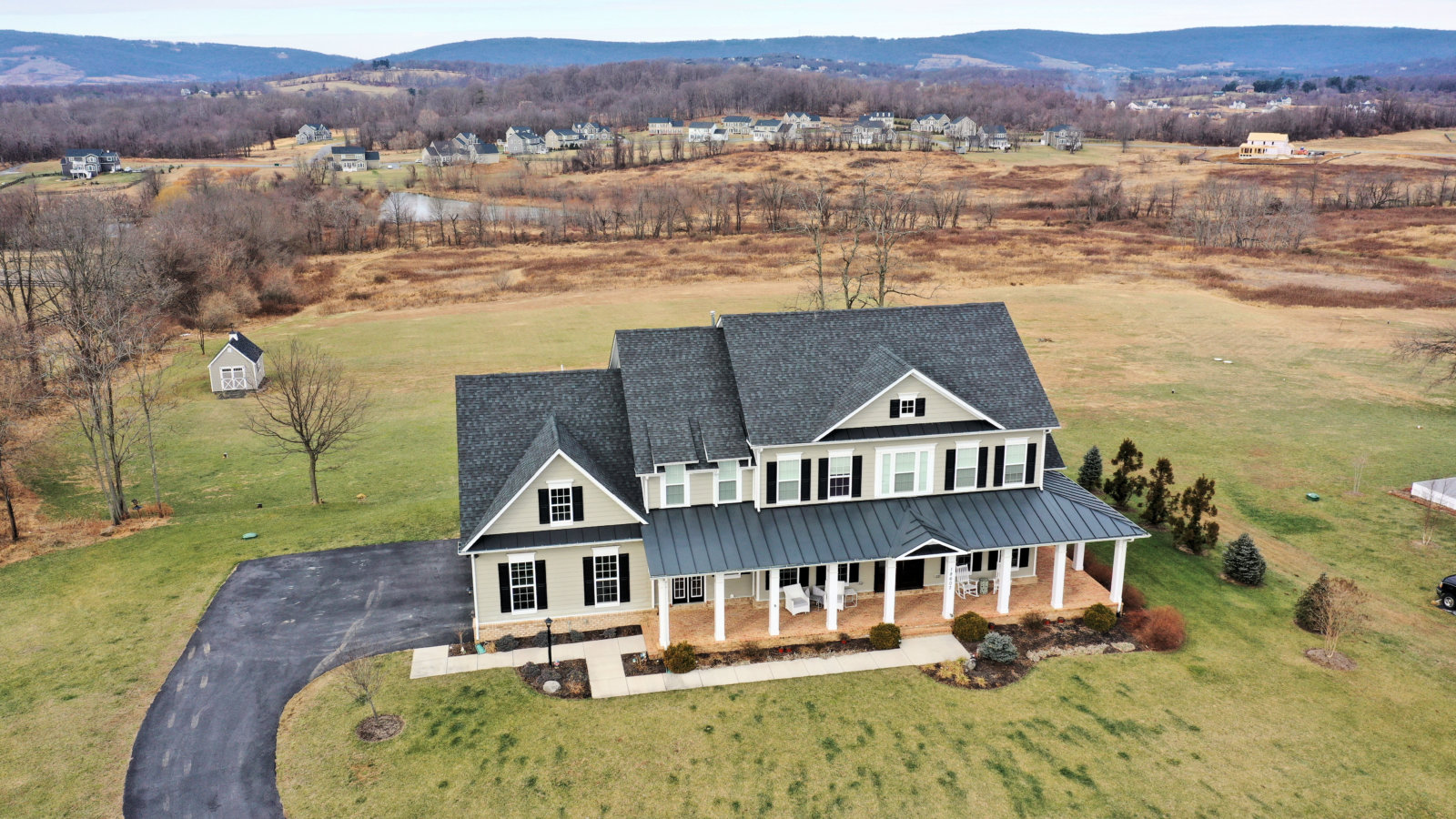 Home for Sale in Purcellville - A Carrington Home in the Black Oak Ridge community. View of the Blue Ridge Mountains behind.