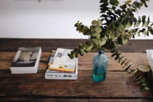 books and plant in a blue bottle