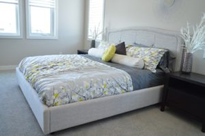 bed with gray and yellow bedcovers